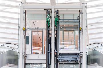 Transparent elevator in modern building