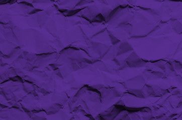 Purple background and wallpaper by crumpled paper texture and free space.