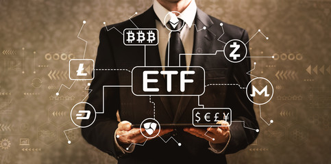 Cryptocurrency ETF theme with businessman holding a tablet computer on a dark vintage background