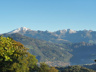 Wonderful aerial landscape at the Orobie Alps, fall season first fresh snow at mountians. Albino, Italy