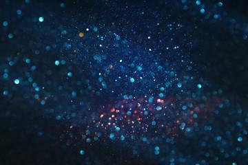 glitter vintage lights background. black and blue. de-focused.