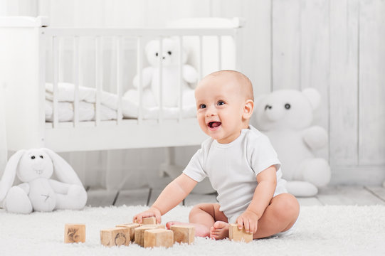 A happy baby is playing