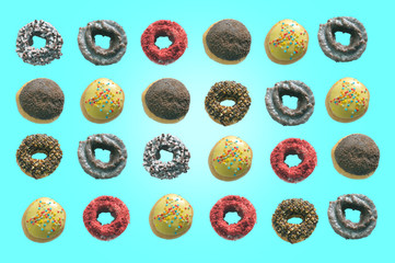 Lay donuts pattern on a blue background. Top view