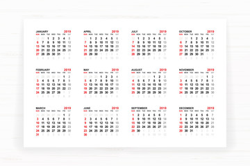 Calendar 2019 year on white paper with wooden texture background. Vector.