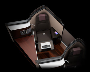 Luxury business class suite interior on black background.  Laptop computer on tray table. 3D rendering image.