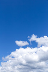 Blue sky background with white clouds, rain clouds.