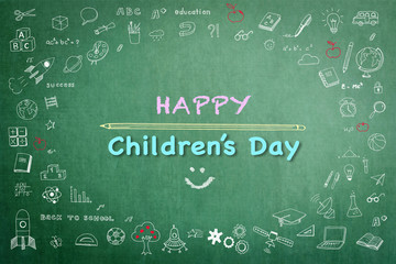 Happy children's day greeting with doodle on green chalkboard for International children's day .