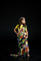 Little baby girl, dressed in a Sari of Indian culture.