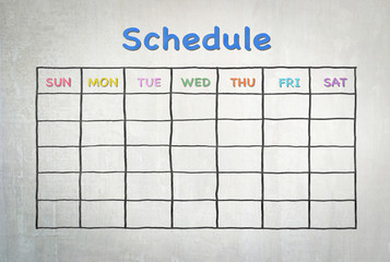 Freehand pen doodle sketch drawing of blank monthly grid timetable schedule on cement wall background