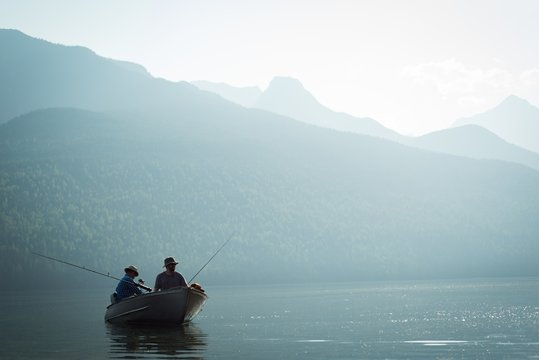 Two fishermen fishing in the river