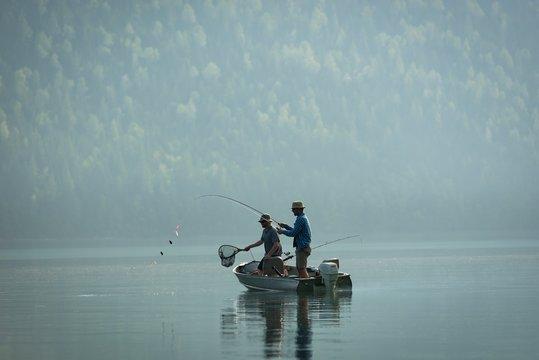 Two fishermen fishing in the river