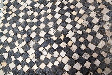 Pavement of black and white. The geometrical pattern. The texture of the pavement