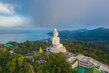 aerial photography scenery blue sky and blue ocean behind Phuket white big Buddha. Phuket white big Buddha is the .famous landmark in Phuket island  a lot of tourists visiting this landmark every day