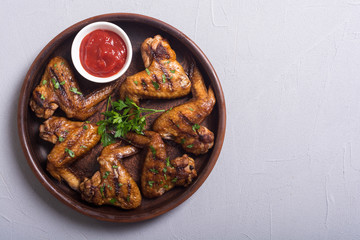 Grilled chicken wings with tomato sauce
