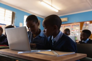 Students using laptop in the classroom