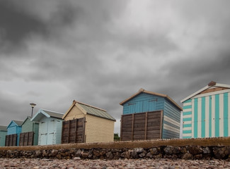 Boarded up beach huts at Budleigh Salterton, East Devon, UK out of season, winter.