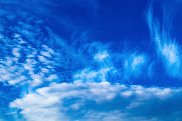 Abstract fantastic white clouds on blue sky background