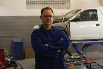 Male mechanic looking at camera