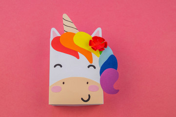 Unicorn of paper on a pink background