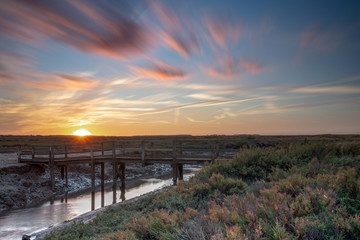 Autumn sunset over the popular Norfolk coast marshes Wall mural