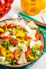 Salad with cheese and fresh vegetables.