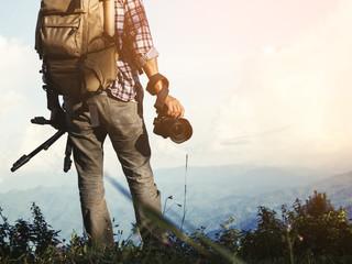 male traveler photographer fascinated by illuminated nature mountains