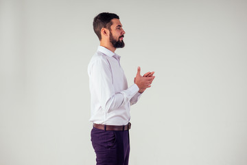 successful businessman standing and applauding on white background