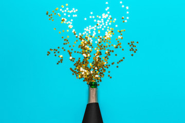 Champagne bottle with colorful party streamers