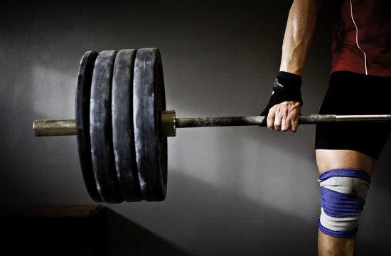 Man practising weightlifting in a crossfit gym
