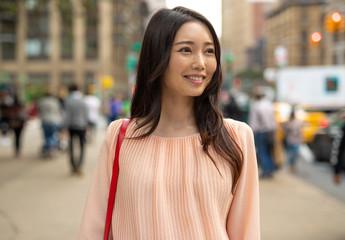 Asian woman in city walking
