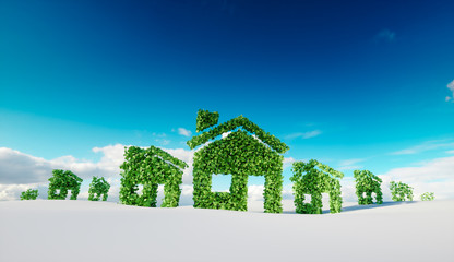 Sustainable eco village concept.  3d rendering of house symbols on winter snow field with blue sky in background.