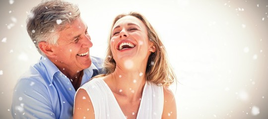 Composite image of happy couple laughing together