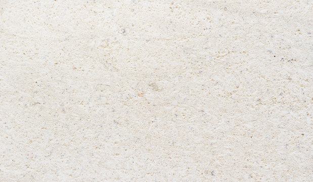 Detailed marble stone. Fragment of limestone wall, stone block background.