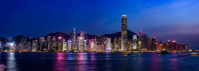 Wide panorama of Victoria Harbor night view at Hong Kong, China