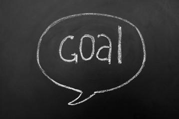 Speech bubble, Goal successful reaching concept on blackboard or chalkboard. Hand drawn inscription.