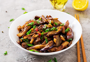 Hot spicy stew eggplant in Korean style with green onion. Aubergine saute. Vegan food