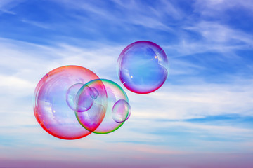 Colored soap bubbles against the sky. Sky background and bubbles.
