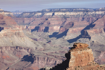 View of the famous Grand Canyon rock formations on a hiking trail