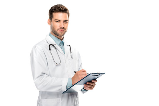 happy male doctor with stethoscope over neck writing in clipboard isolated on white