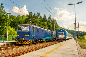 Two blue trains at the station. Rail transport in the Czech Republic. A sunny day on the railroad