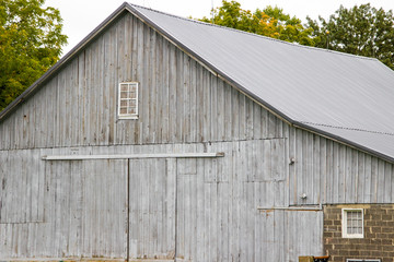 Weathered Rural Barn Background. Grey weathered wooden barn and barn door in the rural American Midwest.