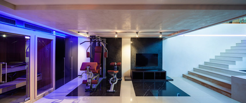 Private gym with tools, sofa and sauna