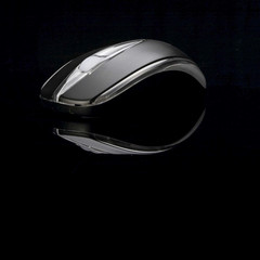Black computer mouse on black background