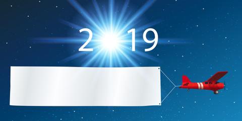 Carte de vœux 2019 montrant un avion rouge tirant une banderole blanche, devant un ciel étoilé