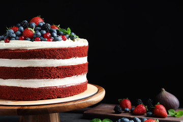 Composition with delicious homemade red velvet cake and space for text on black background