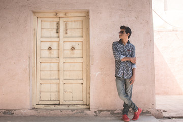 Boy standing besides door