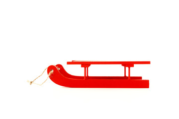Wooden Sledge in Red with Rope isolated on White