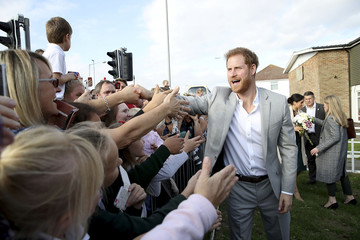 Britain's Meghan Prince Harry meets well-wishers after a visit to the Joff Youth Centre in Peacehaven