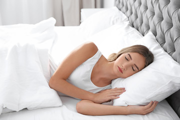 Beautiful teen girl sleeping with comfortable pillow in bed at home