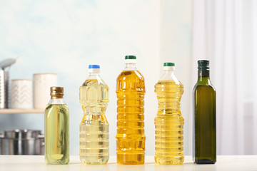 Bottles of oils on table against blurred background